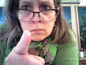 lady with glasses pointing a finger in a corrective stance