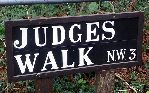 "sign from the UK that says ""judges walk"""