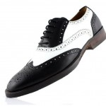 a black and white men's spectator style shoe