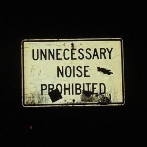 "street sign saying ""Unnecessary noise prohibited"""