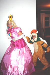 Me dressed as Princess Peach and my son dressed as Bowser