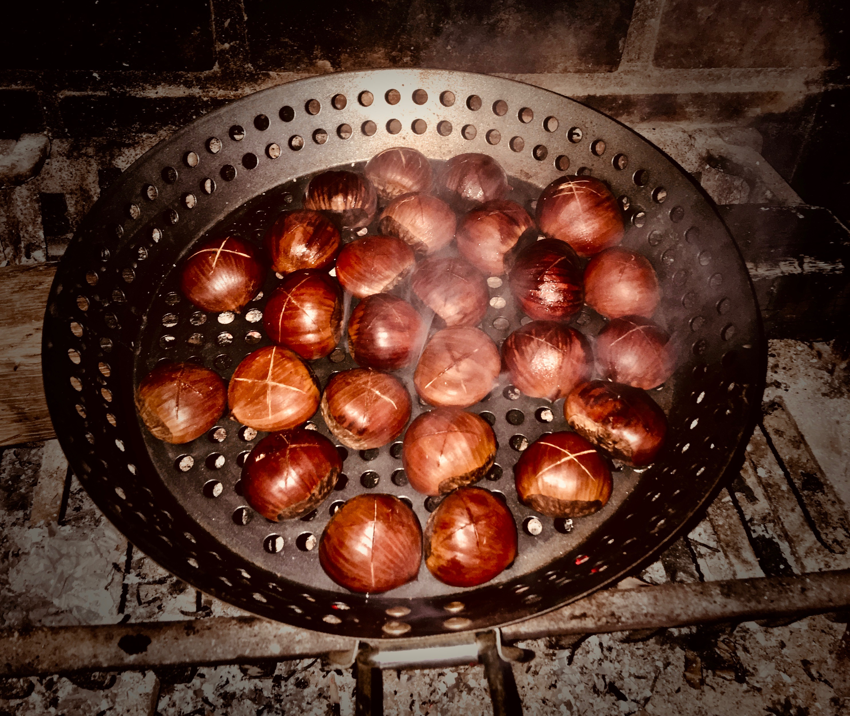 chestnuts on fire in a pan