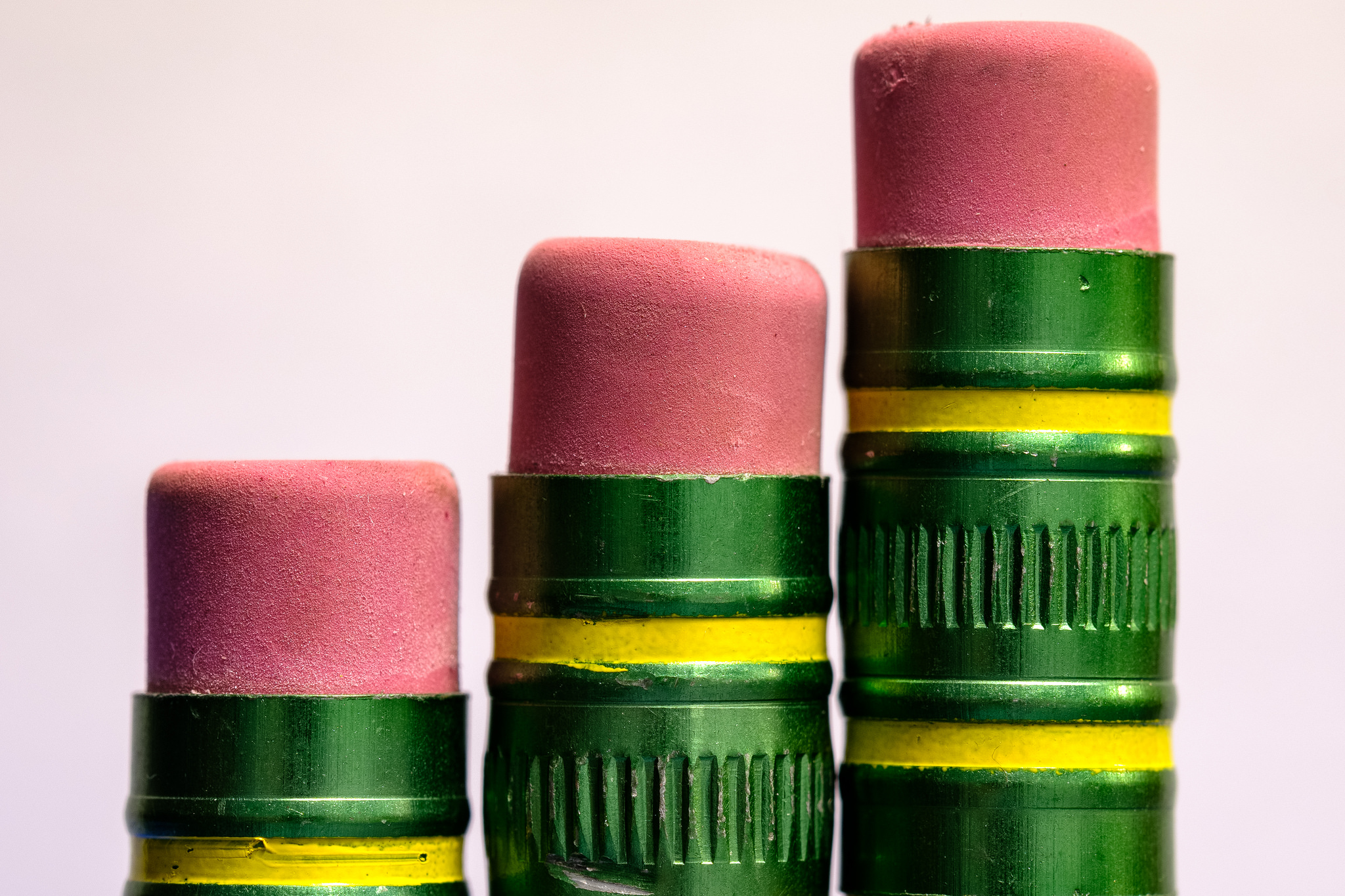 three pencil tops with erasers close up