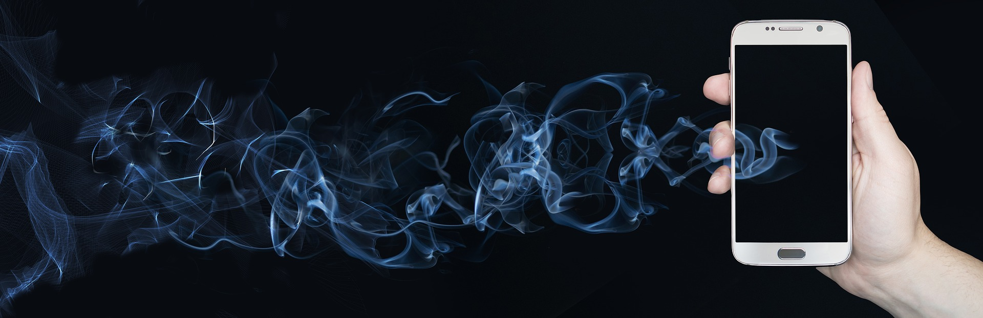Smartphone in human hand, face forward to viewer. Trails of smoke come out of its black (turned off) screen.