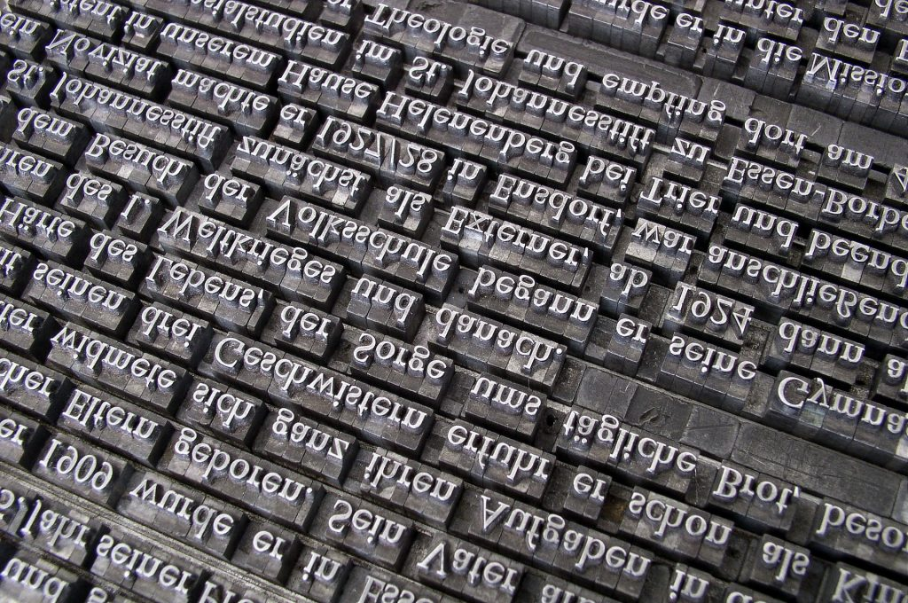 letterpress type blocks arranged in nonsense or foreign words. Serif font. Gray toned.