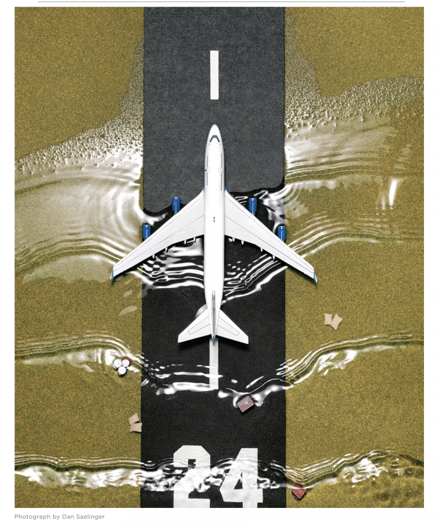 An image of a passenger jet, top-down view, on a runway. The run way is overtaken by water in rippling waves. It is a photo montage credited to Dan Saelinger, from Philadelphia Magazine
