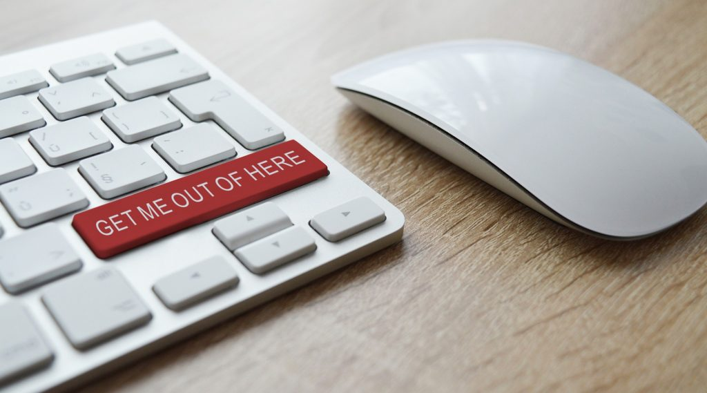 "a close-up of an apple keyboard and mouse. The keyboard has a custom key that is red and says ""GET ME OUT OF HERE"""